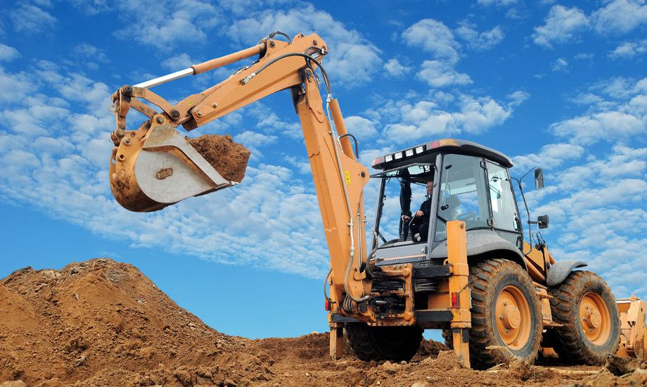 construction industry finance - construction vehicle working on a building site