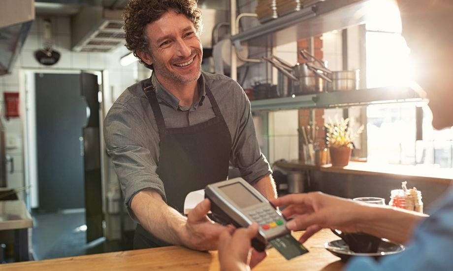 merchant cash advance - business owner accepting payment with card terminal