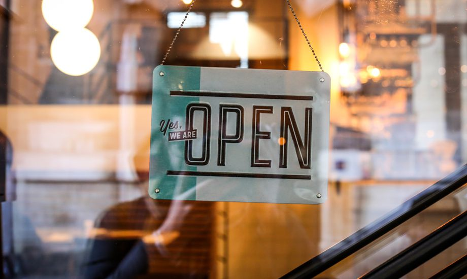 reatil industry finance - retail shop with open for business sign displayed
