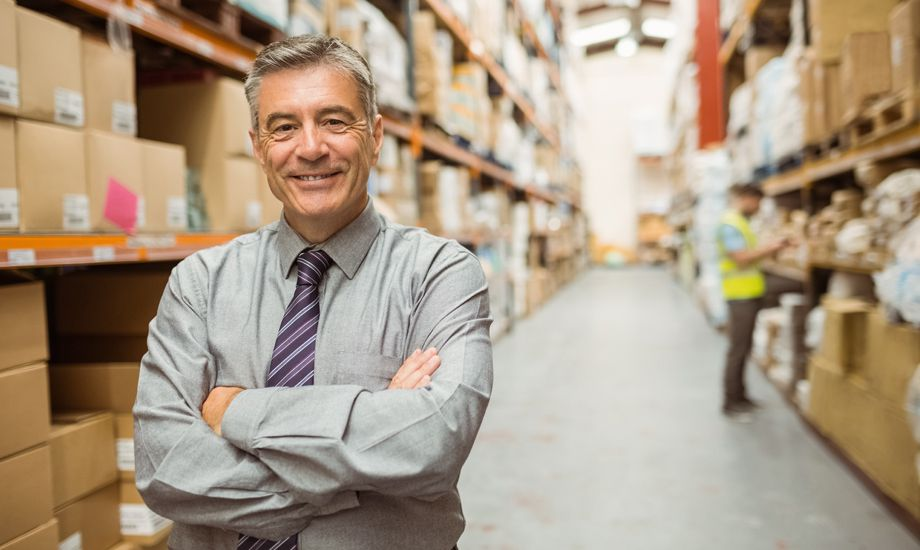 secured vs unsecured business loans- business owner in a warehouse